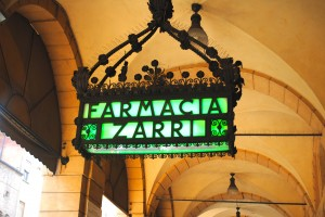 Farmacia sign under portico in Bologna